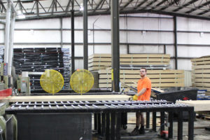 A professional handling material in the warehouse of logistics and distribution company EQ Logistics in Elkhart, IN