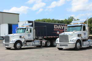 White 18-wheeler trucks owned by third party logistics provider Days Distribution & Logistics in Elkhart, IN